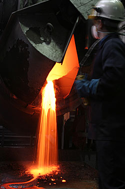 Cupellation furnace pouring litharge (Lead oxide).