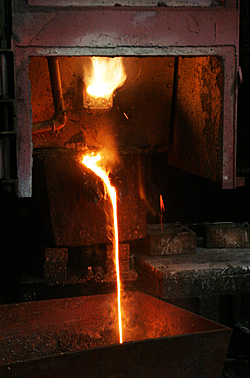 Blast furnace smelting of silver bearing materials producing lead-silver bullion and slag.